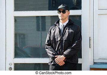 mandlig, security bevogt, beliggende, hos, den, indgang
