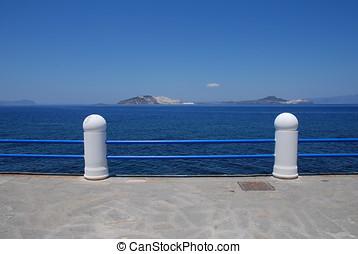 Mandraki seafront, Nisyros - The promenade and railings on...
