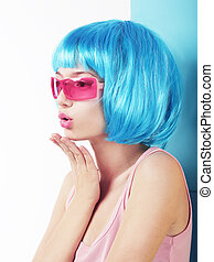 Manga Style. Profile of Charismatic Woman in Blue Wig Blowing a Kiss