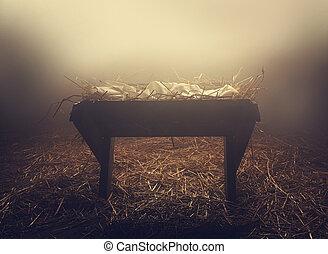 Manger at night under fog - An empty manger at night under...