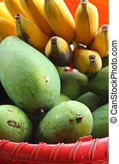 Mango and banana in a basket.