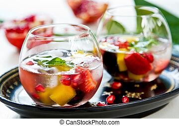 Mango with strawberry, grape and pomegranate sangria