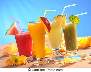 Mango, pineapple, watermelon and kiwi smoothie with drinking...