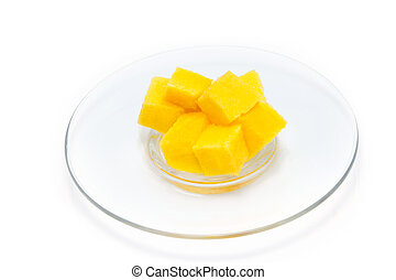 mango slice in plate isolated on white background