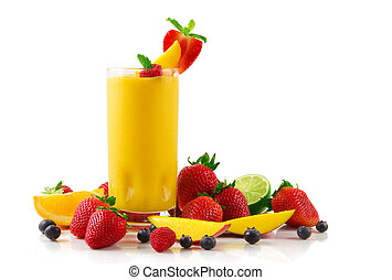 A glass of mango smoothie surrounded by fresh fruits