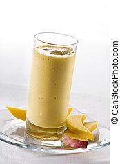 Mango smoothie - Fresh mango smoothie in tall glass close up