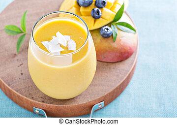 Mango smoothie on a board - Mango smoothie fresh and bright...