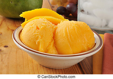 Mango sorbet - A small dish of mango sherbet or sorbet on a...