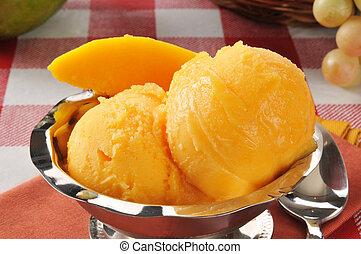 Mango sorbet - Closeup of a bowl of mango sorbet or sherbet...