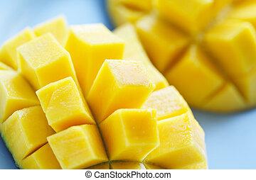 A close up shot of ripe and juicy mangoes
