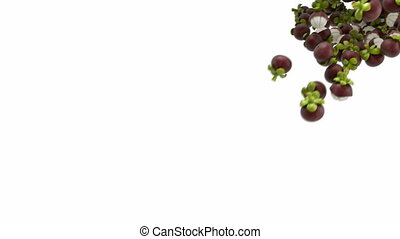 Mangosteen flow with slow motion over white