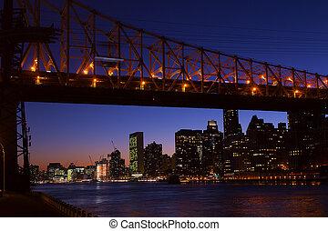 Manhattan and bridge at night