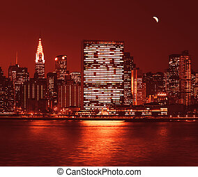 Manhattan at Night with lights and reflections. New York...
