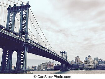 Manhattan bridge and the city in vintage style, New York
