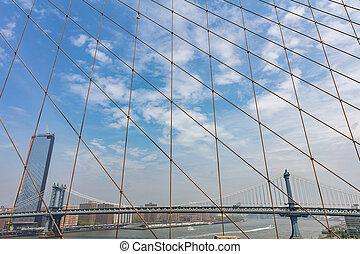 Manhattan Bridge over East river, New York city, view from Brooklyn bridge