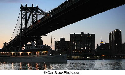 Manhattan Bridge - Boat going under the Manhattan Bridge