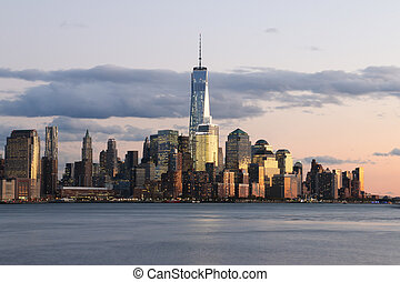 A view of New York City's downtown skyline seen from the Hudson River.