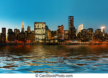 Manhattan. Late evening New York City skyline panorama