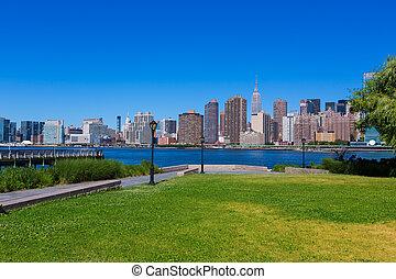 Manhattan New York sunny skyline East River NYC garden park...