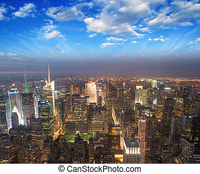 Manhattan, NYC. Spectacular sunset view of Bryant Park and Midtown from the top of Empire State Building.