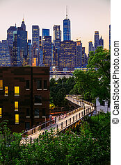 Manhattan panorama at dusk seen from Brooklyn Hights District, New York