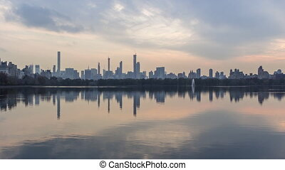 manhattan skyline and reflection in lake