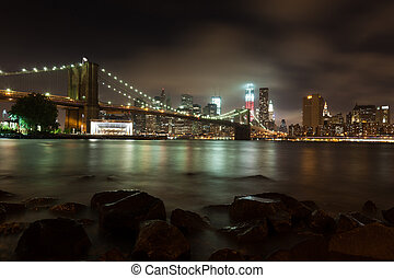 Manhattan skyline by night from Brooklyn bridge park