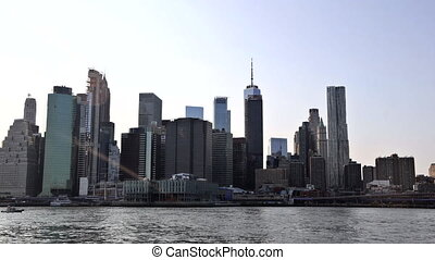 Manhattan Skyline Day to timelapse with view on the skyscrapers of on the East River at New York, US