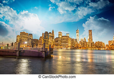 Manhattan skyline with East river reflections at night
