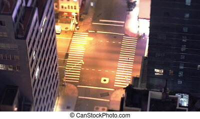 manhattan street scene with traffic and people, nyc, america, tilt shift at night
