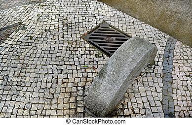 Manhole cover on cement floor