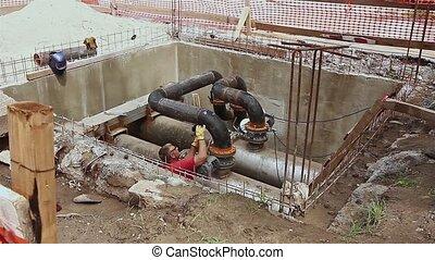 Manhole, metalworker is grinding. - Metal worker is grinding...