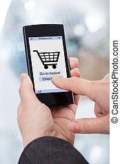 mani, smartphone, fare spese linea