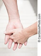 mani titolo portafoglio coppia