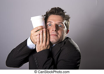 maniac addict businessman holding take away coffee in caffeine addiction