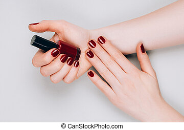 Manicure and bottle of nail polish - Beautiful dark red ...