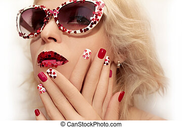 Manicure and makeup with hearts.