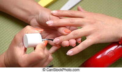 manicure applying foundation