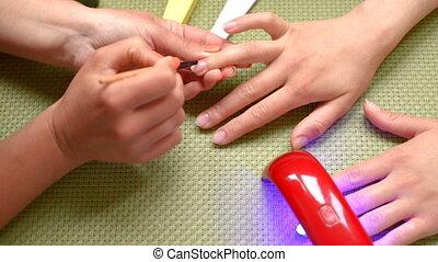 manicure applying foundation