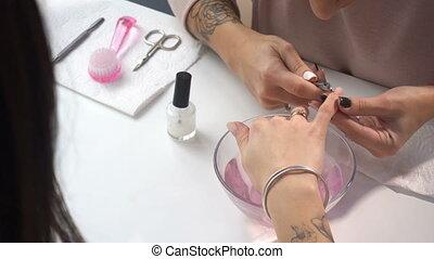 Manicure artist making professional manicure in spa salon....