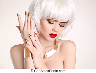 Manicure. Beauty Blonde. Blond bob hairstyle. Fashion girl model with makeup, short hair, manicured nails, golden jewelry set isolated on white background.