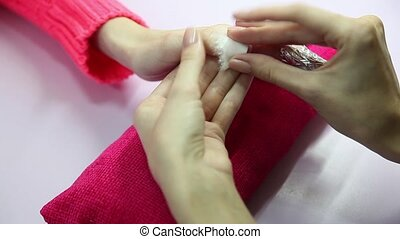 Manicure. Beauty saloon. Close-up. Remove old nail polish. -...