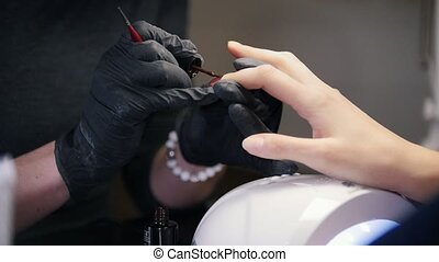 Manicure in beauty salon - fingers and nails, close up