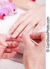 manicure making in beauty spa salon