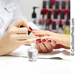 Manicure process... Female hands...