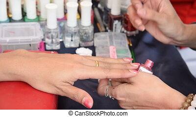 Manicure nail paint.