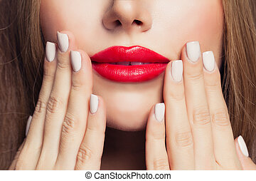 Manicure nails and red female lips