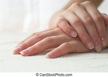 Nice hands on white towel. Soft manicure.