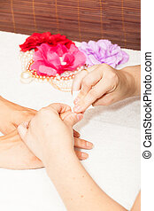Manicure of nails from a woman's hands before applying nail polish
