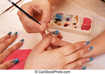 Manicure - Hands during the manicure work.